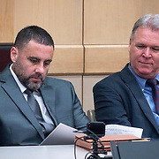 AUGUST 13, 2018---FORT LAUDERDALE, FLORIDA--<br /> Pablo Ibar looks over documents next one of his lawyers, Kevin J. Kulik, as he sits in a courtroom in the Broward County Courthouse at the beginning of a hearing to schedule his new trial. Ibar has been in jail  for 24 years accused of the murders of a bar owner and two models in his house following a home invasion.<br /> (Photo by Angel Valentin)
