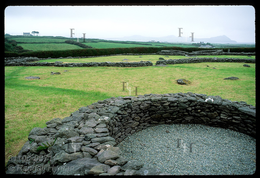 Circular drystone ruins punctuate 5th-century monastic site of Reasc on the Dingle Peninsula. Ireland