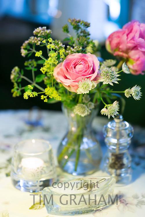 Salt, pepper and vase of flowers at Sonderho Kro Hotel and Restaurant quaint style on Fano Island, Denmark
