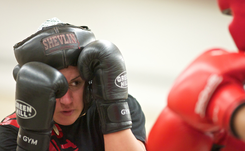 Windsor, Ontario ---10-05-06--- World Welterweight Champion, Mary Spencer, left, spars with a male fighter from her club during a training session at the Windsor Amateur Boxing Club in Windsor, Ontario, May 6, 2010.<br /> GEOFF ROBINS The Globe and Mail