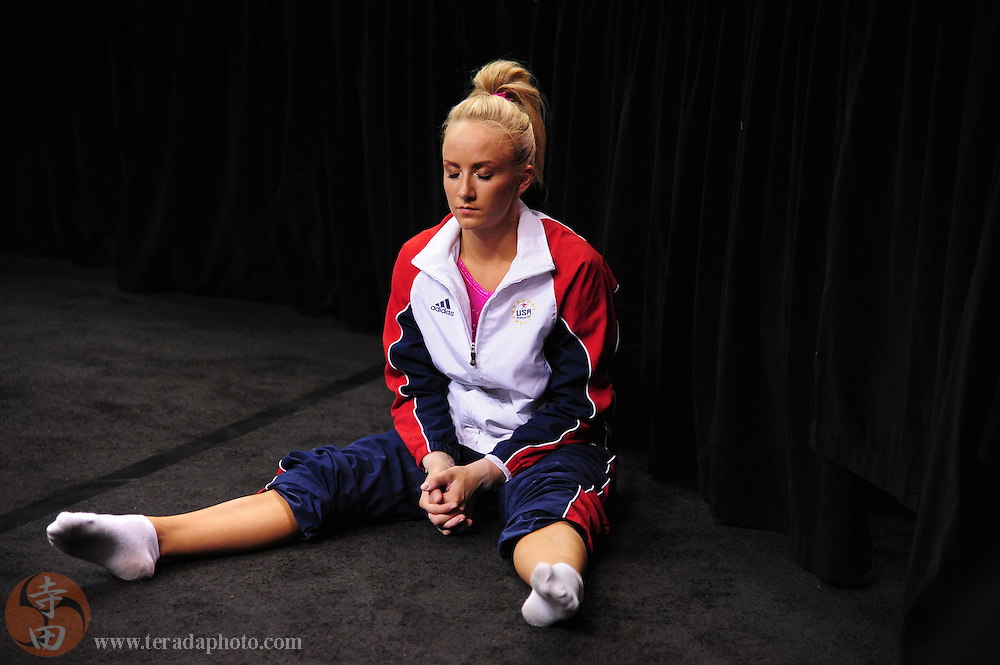 June 29, 2012; San Jose, CA, USA; Nastia Liukin sits on the ground before performing on the balance beam during the 2012 USA Gymnastics Olympic Team Trials at HP Pavilion.
