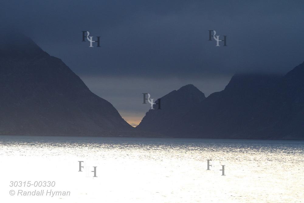 Clouds shroud mountains at 3:30 AM in Smeerenburgfjorden on the north coast of Spitsbergen island; Svalbard, Norway.