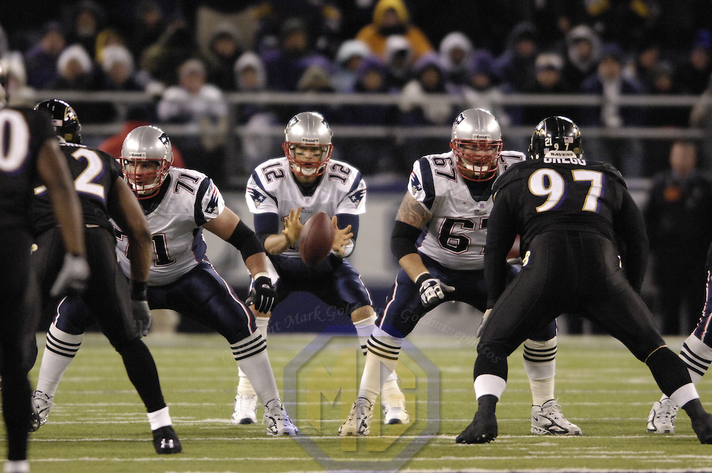 New England Patriots quarterback Tom Brady (12) takes the snap against the Baltimore Ravens on December 3, 2007 at M&T Bank Stadium in Baltimore, Maryland.  The Patriots defeated the Ravens 27-24.