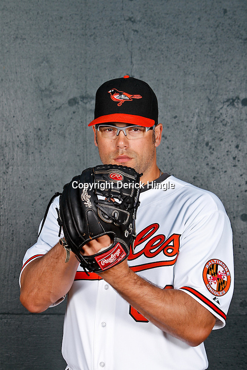 February 26, 2011; Sarasota, FL, USA; Baltimore Orioles relief pitcher Kevin Gregg (63) poses during photo day at Ed Smith Stadium.  Mandatory Credit: Derick E. Hingle