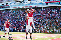 FAYETTEVILLE, AR - NOVEMBER 24:  David Williams #33 of the Arkansas Razorbacks celebrates after scoring a touchdown during a game against the Missouri Tigers at Razorback Stadium on November 24, 2017 in Fayetteville, Arkansas.  The Tigers defeated the Razorbacks 48-45.  (Photo by Wesley Hitt/Getty Images) *** Local Caption *** David Williams