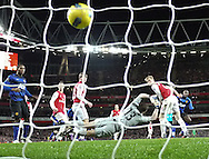 Picture by Andrew Tobin/Focus Images Ltd. 07710 761829. .21/01/12. Danny Welbeck (19) of Manchester United (R) scores past Wojciech Szczesny (13) of Arsenal during the Barclays Premier League match between Arsenal and Manchester United at Emirates Stadium, London.