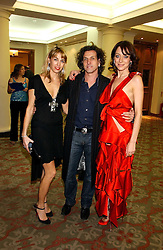 Left to right, STEPHEN & ASSIA WEBSTER, he is the jeweller and MISS DEE at the Lighthouse Gala Auction in aid of the Terrence Higgins Trust held at Christie's, St.James's, London on 15th March 2006.<br />