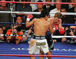 Manny Pacquiao connects with a body shot on Ricky Hatton in the second round of their Light Welterweight title fight at the MGM Grand, Las Vegas , Nevada, 2nd May 2009.