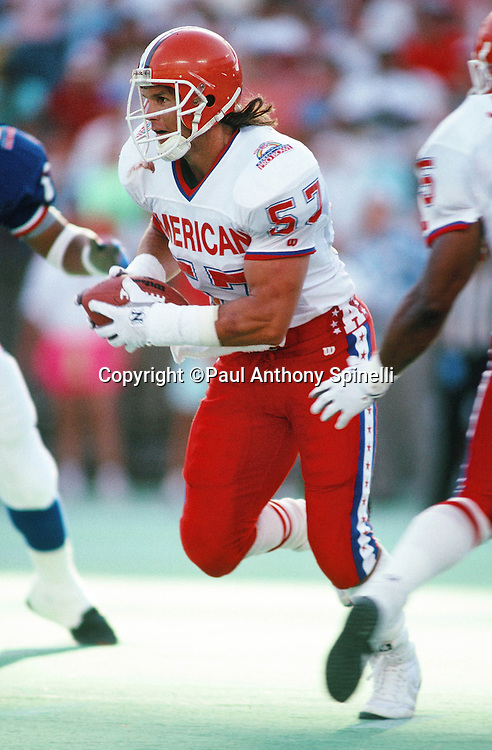 Cleveland Browns linebacker Clay Matthews (57) runs with the ball during the 1990 NFL Pro Bowl between the National Football Conference and the American Football Conference on Feb. 4, 1990 in Honolulu. The NFC won the game 27-21. (©Paul Anthony Spinelli)