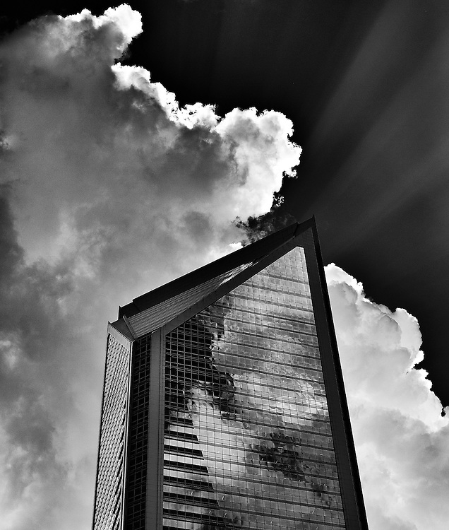Black and white image of the Duke Energy building with dramatic clouds in Charlotte, North Carolina.