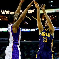 Feb 6, 2013; New Orleans, LA, USA; New Orleans Hornets power forward Ryan Anderson (33) shoots over Phoenix Suns power forward Markieff Morris (11) during  the first quarter of a game at the New Orleans Arena. Mandatory Credit: Derick E. Hingle-USA TODAY Sports