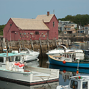 The red fishing shack called Motif #1 in the center of Rockport Massachusetts harbor, is a favorite subject for painters and photographers. It is appreciated for the symmetry of its geometric shapes
