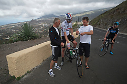F.A.O Lisa McCLean Daily Telegraph picture desk. ©Ben Cawthra. 19/05/2012. Tenerife, Spain. Three time Olympic gold medalist, cyclist Bradley Wiggins (centre) talking with his head coach Shane Sutton (left) and his head conditioner Tim Kerrison (right) during training on the roads surrounding the volcanic island of Tenerife in Spain. Photo credit: Ben Cawthra