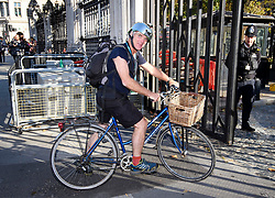 © Licensed to London News Pictures. 22/10/2018. London, UK. Conservative MP DESMOND SWAYNE arrives at the houses of Parliament riding a bike, wearing shots and a silver helmet. Senior Tory MPs have put pressure Prime Minister Theresa May to change her Brexit stance by threatening to mount a leadership challenge. Photo credit: Ben Cawthra/LNP