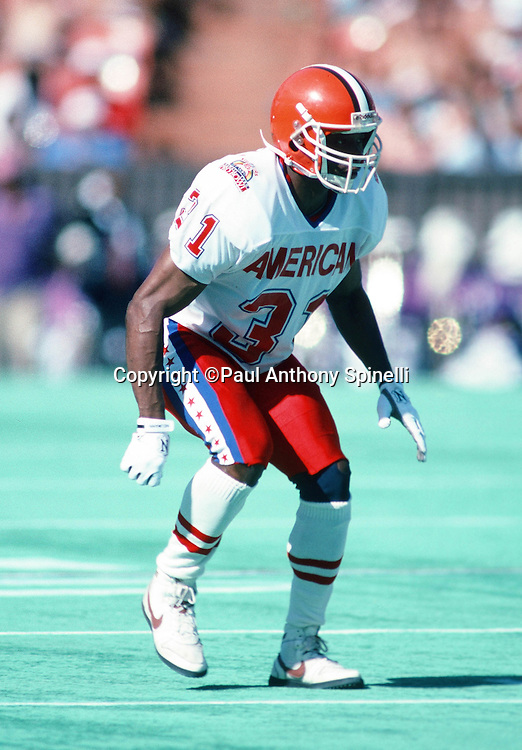 Cleveland Browns cornerback Frank Minnifield (31) drops back in pass coverage during the 1990 NFL Pro Bowl between the National Football Conference and the American Football Conference on Feb. 4, 1990 in Honolulu. The NFC won the game 27-21. (©Paul Anthony Spinelli)
