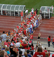 Members of the Ohio State soccer team enter before Ohio State takes on the University of North Carolina in an NCAA women's college soccer game in Columbus, Ohio on Sunday, Sept. 4, 2011, at Jesse Owens Memorial Stadium.