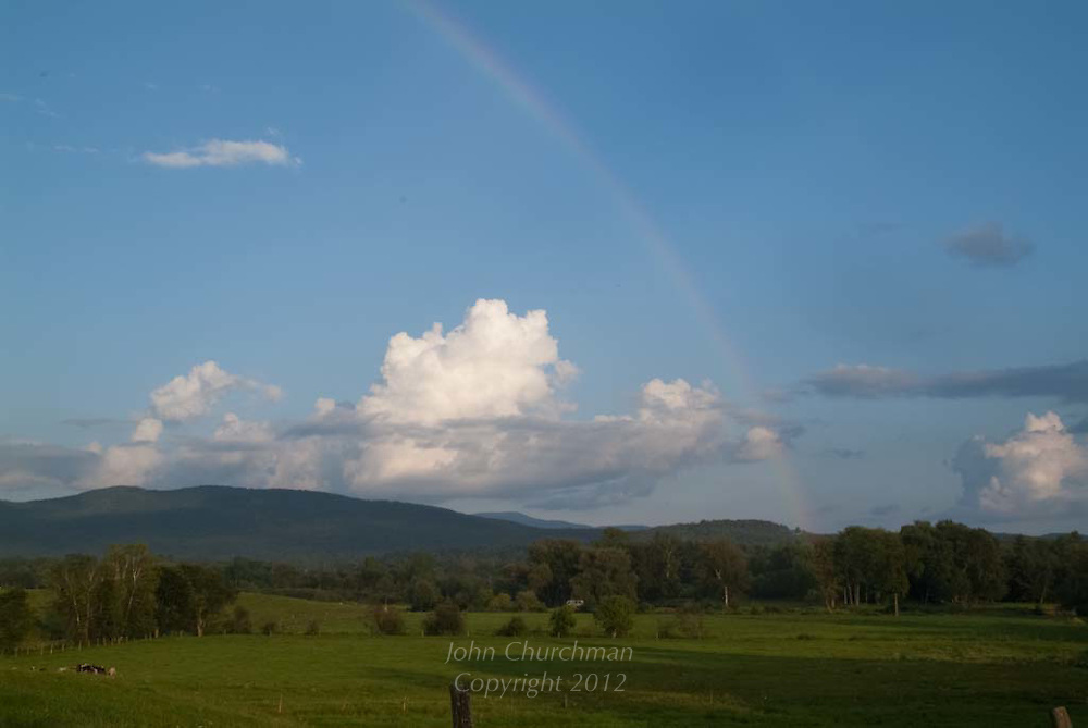 rainbow arching over Vermont farmland