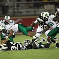 Marshall defensive lineman Marques Aiken (97) tackles Central Florida running back Brynn Harvey (34) during an NCAA football game between the Marshall Thundering Herd and the Central Florida Knights at Bright House Networks Stadium on Saturday, October 8, 2011 in Orlando, Florida. (Photo/Alex Menendez)