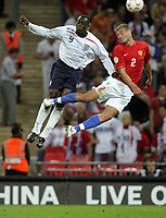 Photo: Rich Eaton.<br /> <br /> England v Russia. UEFA European Championships Qualifying. 12/09/2007. Russia's Vasily Berezutskiy (L) jumps with England's Emile Heskey.