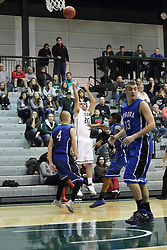 16 November 2013:  Pat Sodemann shoots for three over Tyler Hall  during an NCAA mens division 3 basketball game between the Aurora University Spartans and the Illinois Wesleyan Titans in Shirk Center, Bloomington IL