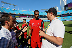 CHARLOTTE, USA - Saturday, July 21, 2018: Liverpool's Joel Matip is interviewed by John Gibbons of the Anfield Wrap after a training session at the Bank of America Stadium ahead of a preseason International Champions Cup match between Borussia Dortmund and Liverpool FC. (Pic by David Rawcliffe/Propaganda)