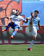 Montreal Impact defender Bakary Soumare (5) and New York City FC defender Andoni Iraola battle for the ball during the first half of am MLS soccer game at Yankee Stadium on Saturday, August 1, 2015, in New York. (AP Photo/Kathy Kmonicek)