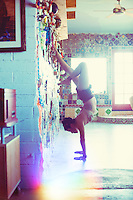Handstand with wall support.