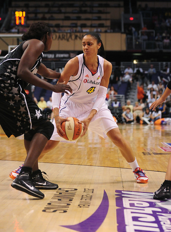 Aug 26, 2010; Phoenix, AZ, USA; Phoenix Mercury forward Candice Dupree (4) drives the ball against San Antonio Silver Stars forward Sophia Young (33) during the first half in game one of the western conference semi-finals in the 2010 WNBA Playoffs at US Airways Center.  The Mercury defeated the Silver Stars 106-93.  Mandatory Credit: Jennifer Stewart-US PRESSWIRE
