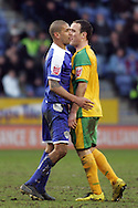 Leicester - Saturday, February 16th, 2008: Patrick Kisnorbo (L) of Leicester City and Iain Hume (R) of Norwich City clash during the Coca Cola Champrionship match at the Walkers Stadium, Leicester. (Pic by Mark Chapman/Focus Images)