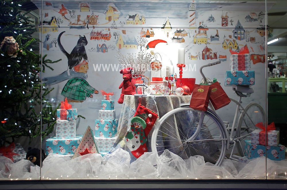 Warwick, N.Y. - A store window is decorated for the holidays on the evening of Dec. 12, 2009.