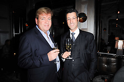 Left to right, BILL ENNIS and ANDREA CRIPPA at a dinner hosted by Ruinart in honour of Amanda Wakely at The Connaught, Carlos Place, London on 20th October 2010.