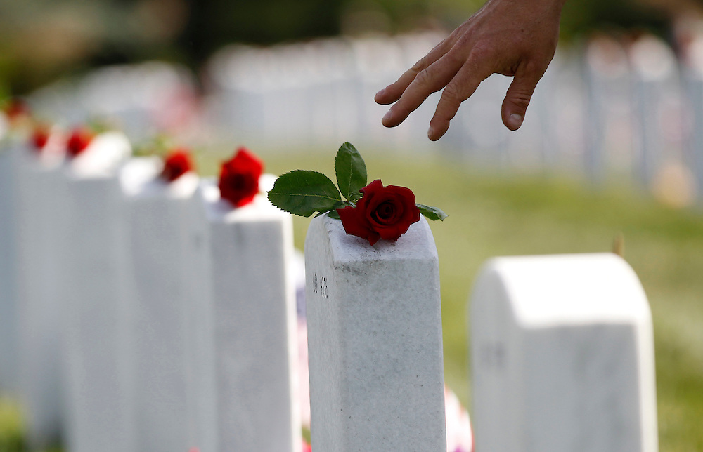 A rose is placed on a grave stone on Memorial Day at Arlington National Cemetery in Arlington, Virginia, Monday, May 27, 2013.