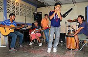 Members of the group 'Los Sin Casa' rehearse for a performance, led by music teacher William Guardado of the Music for Hope youth project based in Nueva Esperanza, El Salvador.