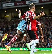 Ricardo Vaz Te of West Ham United is fouled by Ben Davies of Sheffield United during the Capital One Cup match at the Boleyn Ground, London<br /> Picture by David Horn/Focus Images Ltd +44 7545 970036<br /> 26/08/2014