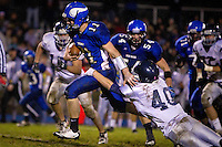 Coeur d'Alene High quarterback Chad Chalich makes a break up the middle of the field as Beau Martz from Lake City High attempts to drag him down from behind during the second half of the Vikings 45-13 win Friday over the Timberwolves.