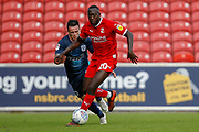Swindon Town forward Keshi Anderson (10) goes past Bury defender Callum McFadzean (21) during the EFL Sky Bet League 2 match between Swindon Town and Bury at the County Ground, Swindon, England on 15 September 2018.