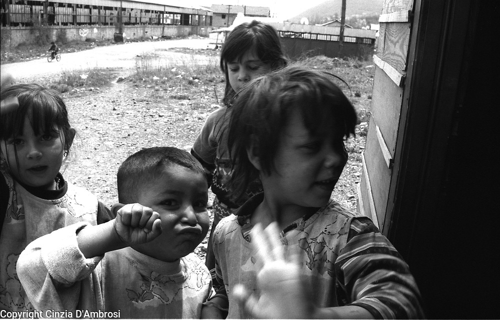 Roma in the Mitrovice illegal camp. Roma are unwanted and heavily discriminated. In Mitrovice they settled in the camp adjacent to the rubbish dump of the city. Medicos del Mundo is the only ngo left that is giving them any aid. A wooden hut dedicated to schooling has being built by the ngo within the camp. Children seem to attend because of the promise of food.