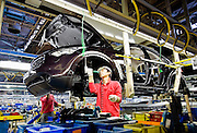 A worker works on a vehicle at Nissan Motor Co.s assembly plant in Tochigi, Japan on Thursday 12 Nov.  2009.