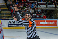 KELOWNA, CANADA - JANUARY 7: Referee Chris Crich makes a call at the Kelowna Rockets against the Kamloops Blazers on January 7, 2017 at Prospera Place in Kelowna, British Columbia, Canada.  (Photo by Marissa Baecker/Shoot the Breeze)  *** Local Caption ***