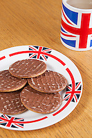 Chocolate biscuits on plate with British coffee mug