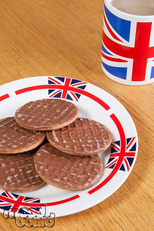 Chocolate biscuits on plate with British coffee mug