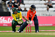 Tammy Beaumont of England is hit on the helmet grill by the ball as an attempted scoop shot goes wrong during the International T20 match between England Women Cricket and South Africa at the Cooper Associates County Ground, Taunton, United Kingdom on 20 June 2018. Picture by Graham Hunt.