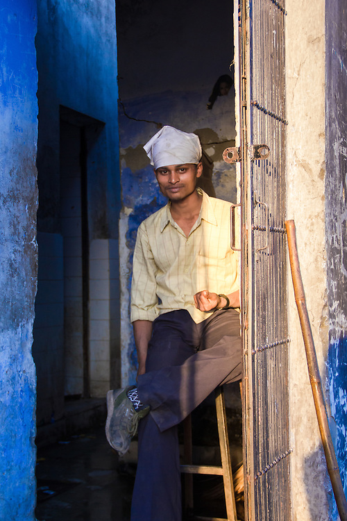 A curious young man in a doorway at sunset (Delhi, India, 2011).<br />