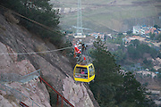 YUEYANG, CHINA - DECEMBER 21: (CHINA OUT) <br /> <br /> Santa Claus Climbs Zip Line To Distribute Christmas Gifts <br /> <br /> A worker of Shiniuzhai Scenic Spot dressed as Santa Claus distributes Christmas gifts through zip line at Pingjiang County on December 21, 2014 in Yueyang, Hunan province of China. A worker dressed as Santa Claus hand out Christmas presents to welcome the upcoming Christmas Day, which will fall on Tuesday.<br /> ©Exclusivepix Media