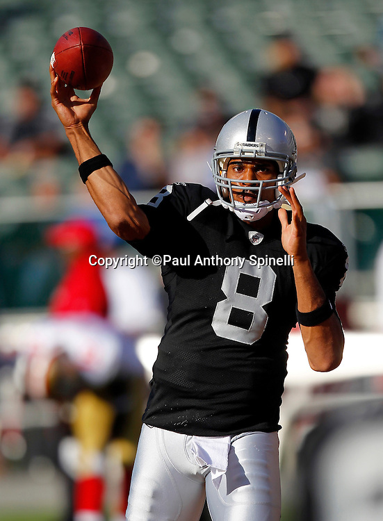 Oakland Raiders quarterback Jason Campbell (8) throws a pregame pass during the NFL preseason week 3 football game against the San Francisco 49ers on Saturday, August 28, 2010 in Oakland, California. The 49ers won the game 28-24. (©Paul Anthony Spinelli)