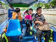 09 SEPTEMBER 2016 - BANGKOK, THAILAND:  Passengers on the new Khlong Phadung Krung Kasem boat. Trial services have started on a 5-kilometre boat route on Khlong Phadung Krung Kasem between Hua Lamphong and Thewes piers. The service is operated by the Bangkok Metropolitan Administration (BMA). The city is using converted garbage boats, fitted with seats, awnings and life preservers. If the trial run is successful regular passenger boats will be put on the route.      PHOTO BY JACK KURTZ