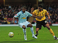 Photo: Tony Oudot/Sportsbeat Images.<br /> Watford v Colchester United. Coca Cola Championship. 10/11/2007.<br /> Kevin Lisbie of Colchester is challenged by Aidy Mariappa of Watford