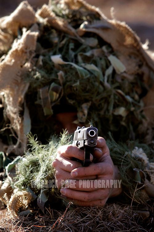 ABBOTTABAD, DECEMBER 18: A soldier from the People's Liberation Army of China (PLA) takes aim with his weapon during a military exercise with Pakistani forces in Abbottabad, Pakistan on Monday December 18, 2006. Pakistan and China completed 10 days of military exercises in northern Pakistan to further their militaries' anti-terrorist capabilities. (Photo by Warrick Page)