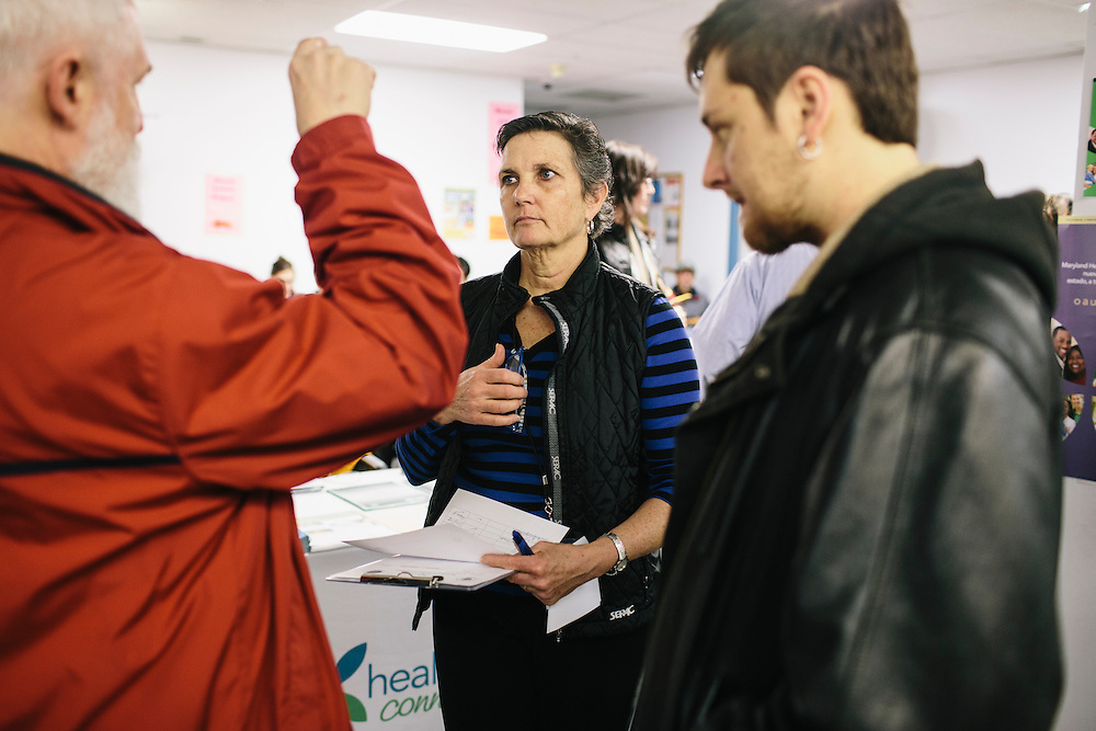 Mary Anderson, public information officer for the Maryland Department of Health and Human Services, answers questions from residents trying to sign up for health insurance under the Affordable Care Act on Dec. 7, 2013. Maryland's state-run health-insurance exchange is lagging behind other states, despite strong support among Maryland leaders for President Barack Obama's health law. Only 3,000 acquired private health coverage in the first two months in a state with about 600,000 uninsured. CREDIT: Greg Kahn for The Wall Street Journal. MARYLAND