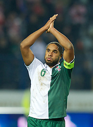 OSIJEK, CROATIA - Tuesday, October 16, 2012: Wales' captain Ashley Williams applauds the travelling supporters after his side's 2-0 defeat by Croatia during the Brazil 2014 FIFA World Cup Qualifying Group A match at the Stadion Gradski Vrt. (Pic by David Rawcliffe/Propaganda)